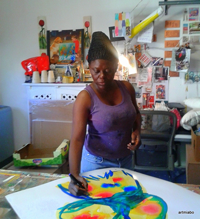 Miabo painting in her studio