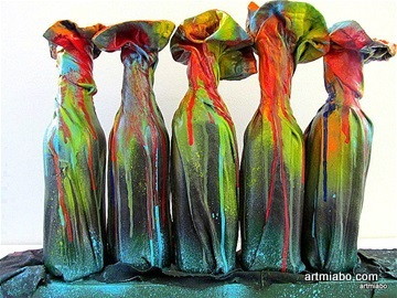Miabo's jeans sculpture: five bottles covered in multi-colored painted jeans