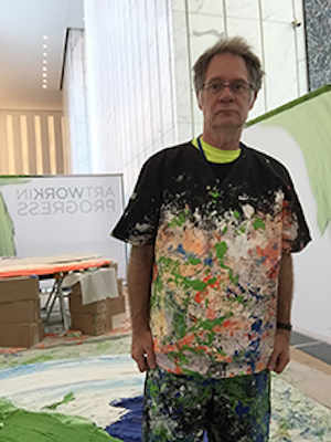 Donald Martiny in One World Trade Center Studio wearing a paint-covered shirt