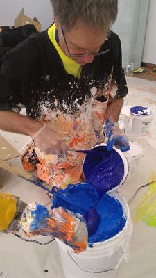 Donald Martiny mixing blue paint for his artwork.