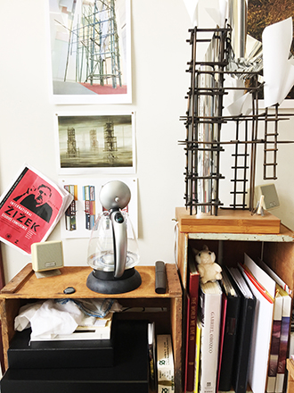 Maquettes, books and an image of a painting by Kay Sage