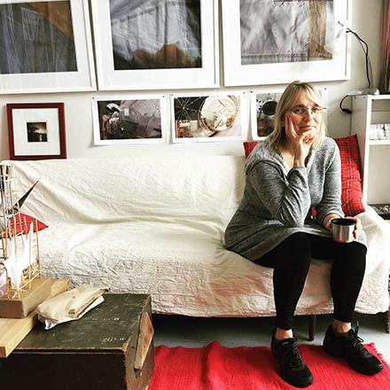 Sue Wrbican on the sofa in her studio