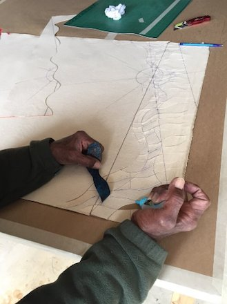 Mohan Sundaresan cutting two paintings into wavy strips